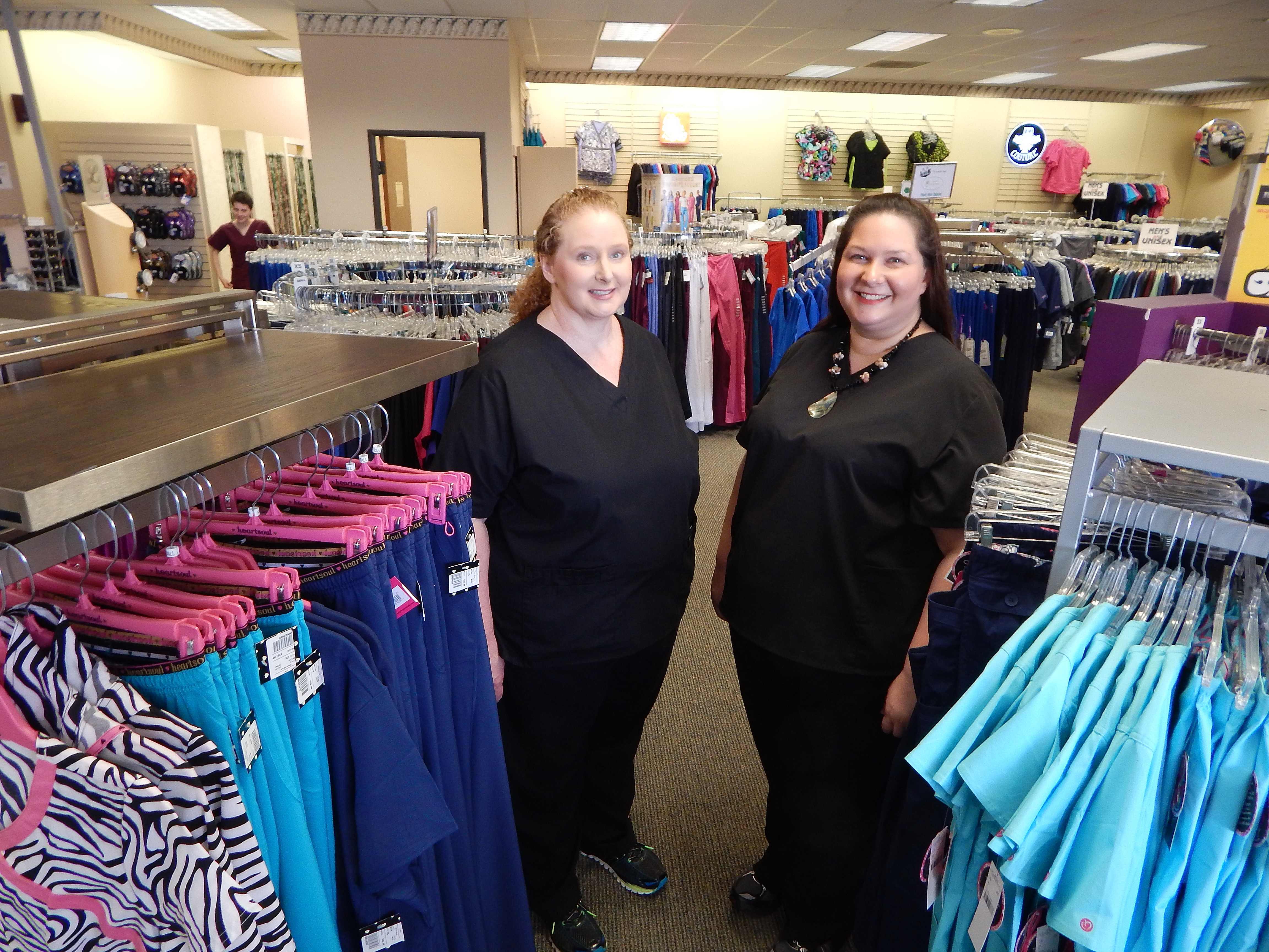 Uniform Shoppe manager Shari Stallings and sales associate Ericka Branham-Stapp stand ready to serve.